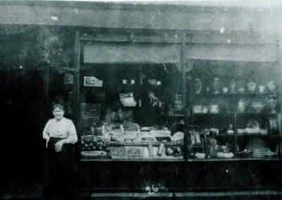 25 Mrs Cooper Outside Her Shop In Chapel St